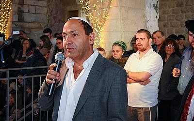 Rami Levy attends a candle lighting ceremony in the Mamilla mall in Jerusalem, on December 18, 2017. (Mendy Hechtman/Flash90)