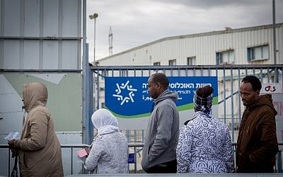 African asylum seekers wait outside the Israeli Population and Immigration Authority office waiting to find out their status, in Bnei Brak, Israel, February 13, 2018. (Miriam Alster/FLASH90)