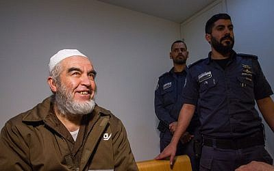 Leader of the northern branch of the Islamic Movement in Israel, Sheikh Raed Salah, arrives for a court hearing at the Haifa Magistrate's Court on February 26, 2018. (Flash90)