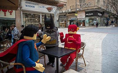 Israelis dressed up in costumes for the Jewish festival of Purim in downtown Jerusalem on February 27, 2018. (Yonatan Sindel/Flash90)