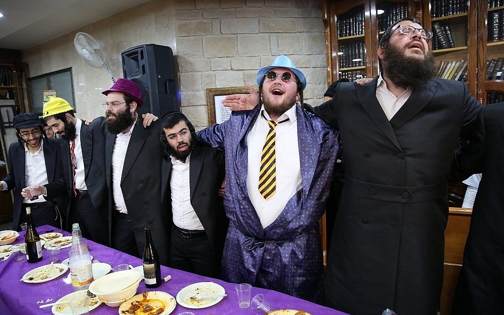 Ultra-Orthodox Jews dressed up in costumes celebrate the Jewish holiday of Purim in Meron on March 1, 2018. (David Cohen/Flash90)