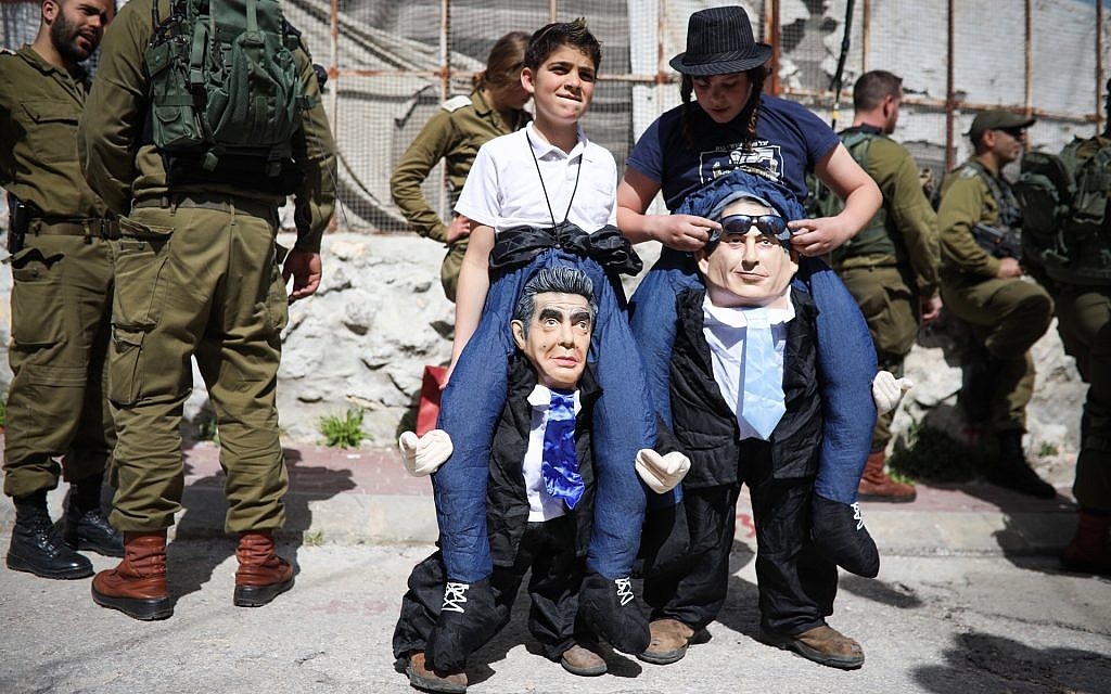 Jews in costumes participate in the annual parade marking the Jewish holiday of Purim in the West Bank city of Hebron on March 1, 2018. (Hadas Parush/Flash90)