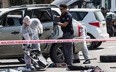 Police at the scene of a suspected ramming attack in the northern city of Acre on March 4, 2018. (Meir Vaknin/Flash90)