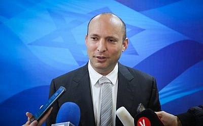 Education Minister Naftali Bennett speaks with the press ahead of the weekly cabinet meeting at the Prime Minister's Office in Jerusalem, on March 11, 2018. (Marc Israel Sellem/Pool)