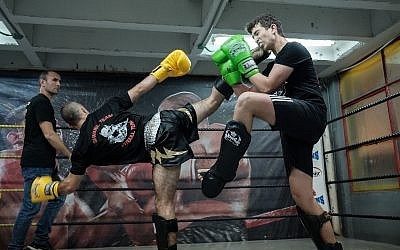 Fighters exchange kicks during a kickboxing competition at Nakash Boxing Gym in Tel Aviv, March 10, 2018. (Yaniv Nadav/Flash90)