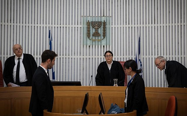 Supreme Court President Esther Hayut (C) and judges Hanan Melcer and Neil Hendel arrive to hear an an appeal against deportation of African asylum seekers at the Supreme Court in Jerusalem on March 12, 2018. (Hadas Parush/Flash90)
