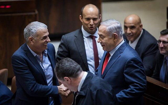 Moshe Kahlon, left, Naftali Bennett, center, and Benjamin Netanyahu in the Knesset on March 13, 2018. (Hadas Parush/Flash90)