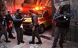 Security personnel at the scene where a security guard was attacked and seriously injured in a terror attack in the Old City of Jerusalem, March 18, 2018. (Yonatan Sindel/ FLASH90)