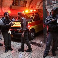 Security personnel at the scene where a security guard was attacked and seriously injured in a terror attack in the Old City of Jerusalem, March 18, 2018. (Yonatan Sindel/Flash90)
