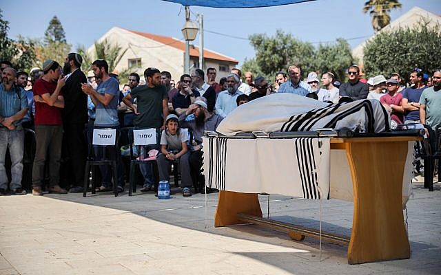 Mourners attend the funeral of Adiel Kolman in the West Bank settlement of Kochav Hashahar on March 19, 2018. (Hadas Parush/Flash90)
