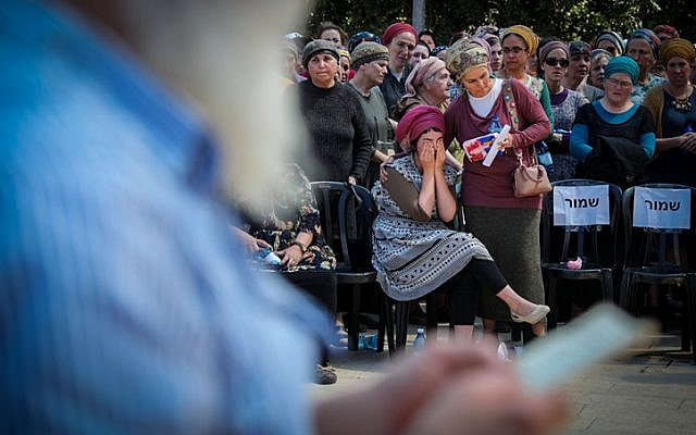 Family and friends attend the funeral of Adiel Kolman, 32-year-old father of four in Kochav Hashahar settlement in the West Bank on March 19, 2018,(Hadas Parush/Flash90)