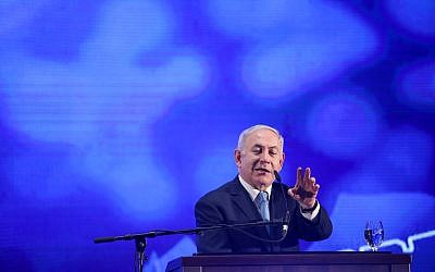 Prime Minister Benjamin Netanyahu speaks during a rally with his supporters and for the Jewish holiday of Passover in Tel Aviv, March 22, 2018. (Hadas Parush/Flash90)