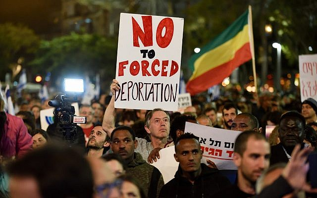 African asylum seekers and human rights activists protest against deportation of asylum seekers at Rabin Square in Tel Aviv on March 24, 2018. (Gili Yaari/Flash90
