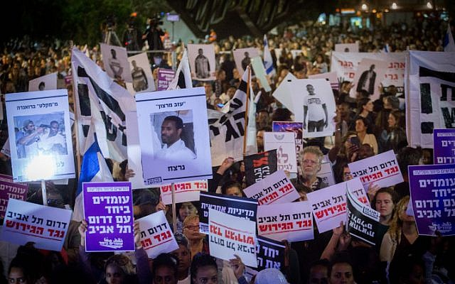 African asylum seekers and activists protest against plans to deport migrants at Rabin Square in Tel Aviv on March 24, 2018. (Miriam Alster/Flash90)