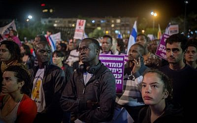African asylum seekers and activists protest plans to deport migrants, at Rabin Square in Tel Aviv, on March 24, 2018. (Miriam Alster/ Flash90)
