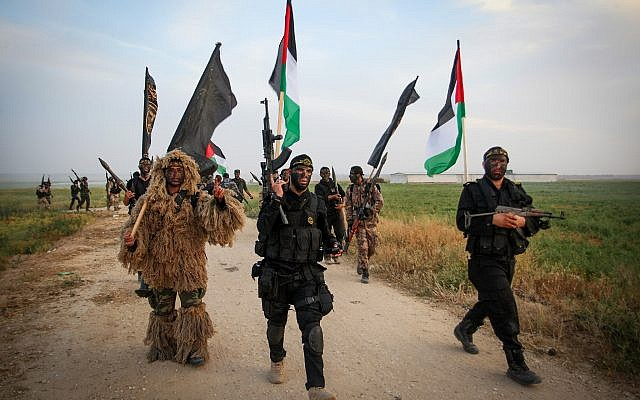 Palestinian Islamic Jihad militants march during a military drill near the border with Israel, east of the town of Khan Younis in the southern Gaza Strip, on March 27, 2018. (Abed Rahim Khatib/ Flash90)