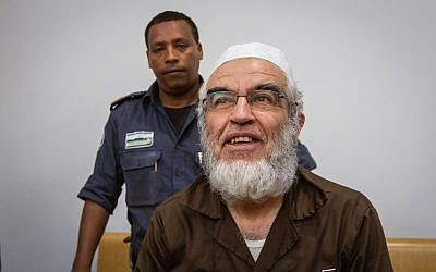 Leader of the northern branch of the Islamic Movement in Israel, Sheikh Raed Salah, arrives for a court hearing at the Haifa Magistrate's Court on March 29, 2018. (Flash90)