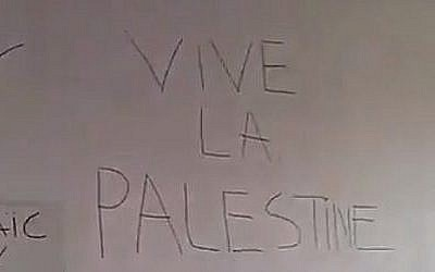 Screen capture from video showing anti-Israel graffiti found in the offices of the French Jewish Students Union at the Pantheon-Sorbonne campus of the University of Paris, March 28, 2018. (Twitter)