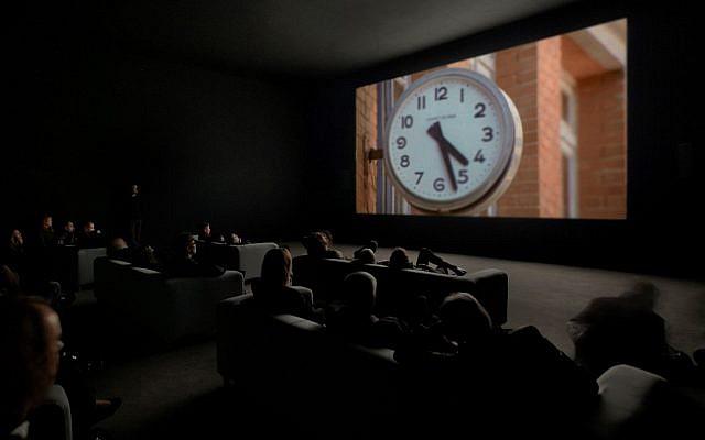 Christian Marclay's installation 'The Clock' at the Tel Aviv Museum of Art in 2018. (Courtesy Tel Aviv Museum of Art)