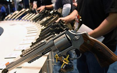 Handguns displayed at the Smith Wesson booth at the National Shooting Sports Foundation's Shooting, Hunting, Outdoor Trade Show in Las Vegas, Nevada. The SHOT Show, January 19, 2016. (Photo by Ethan Miller/Getty Images)