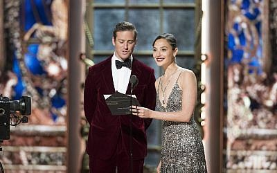 Armie Hammer, left, and Israeli actress Gal Gadot presenting the Academy Award for best hair and makeup at the ceremony in Los Angeles, March 4, 2018. (Craig Sjodin /Getty Images via JTA)