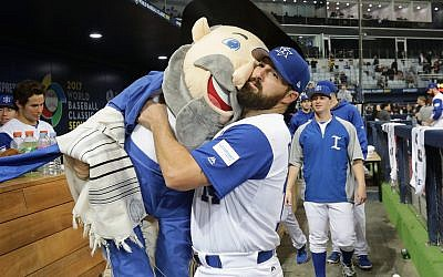 Infielder Cody Decker #14 of Israel holds team mascot The Mensch after the World Baseball Classic Pool A Game Five between Netherlands and Israel at Gocheok Sky Dome on March 9, 2017 in Seoul, South Korea. (Photo by Chung Sung-Jun/Getty Images)