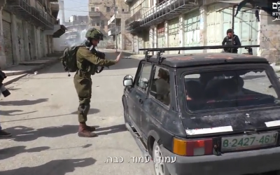 Footage of an IDF soldier stopping a Palestinian car in the West Bank city of Hebron on February 16, 2018. (Screen capture/YouTube)