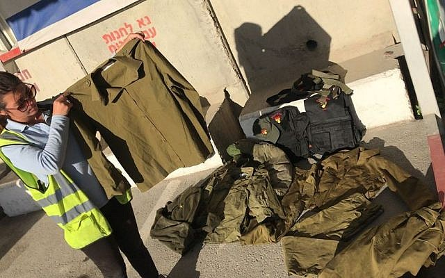IDF uniforms caught at the Kerem Shalom border crossing as they were being smuggled into Gaza. (Defense Ministry)