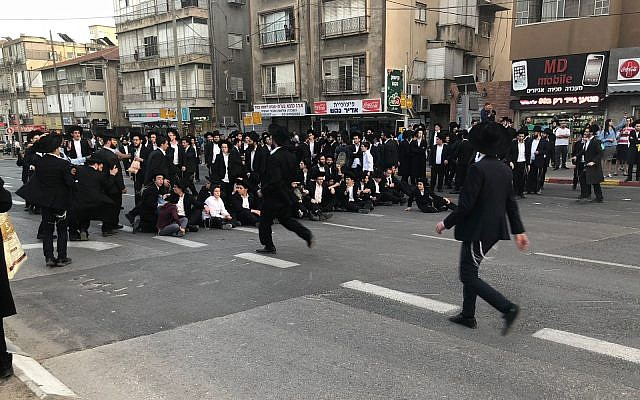 Ultra-Orthodox protesters block a road during an anti-draft protest in Bnei Brak on March 22, 2018. (Israel Police)