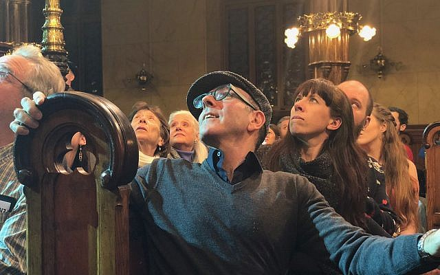 Audience members craned their necks and turned around in their seats during the performance of 'Morning Star' at the Eldridge Street Synagogue on Tuesday, March 20, 2018. (Danielle Ziri/Times of Israel)