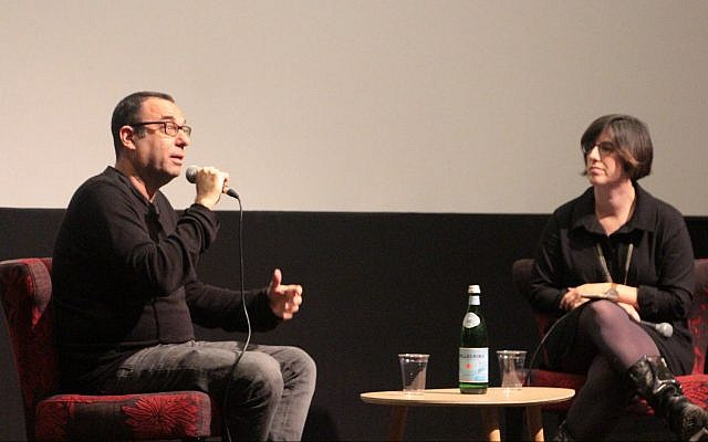 'Kipat Barzel' writer Avner Bernheimer (left) speaks with The Times of Israel's culture editor Jessica Steinberg about his TV series focusing on an ultra-Orthodox unit in the army, March 18, 2018 at the Jerusalem Cinematheque. (Daniel Laufer)