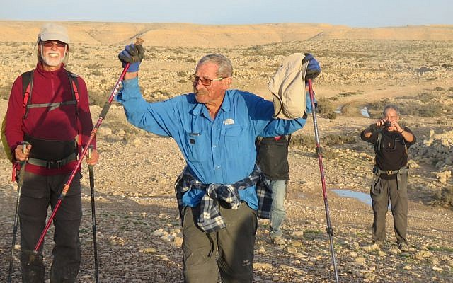 Trip leader Shuka Revak, 86, fulfills a life-long dream as he reaches Avdat in Israel from Jordan's Petra, February 2018. (courtesy)