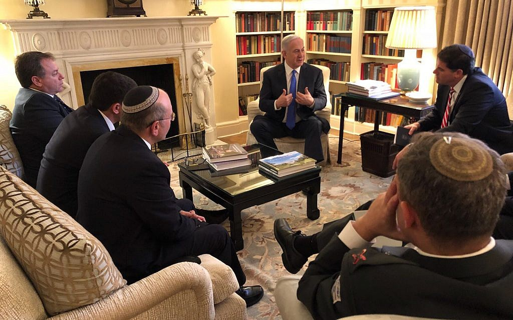 Prime Minister Benjamin Netanyahu consults with his advisers before meeting US President Donald Trump at the White House on March 5, 2018. (Haim Zach/GPO)