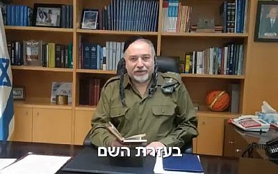 Defense Minister Avigdor Liberman appears in fancy dress in a Purim video, March 1, 2018. (Screen capture: Twitter)