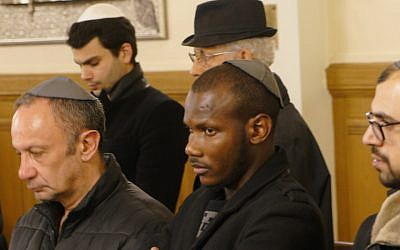 Lassana Bathily praying with members of the Jewish community at the Tournelles Synagogue in Paris, March 28, 2018. (Cnaan Liphshiz, JTA)