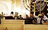 Rabbi Michael Azoulay, second from right, reading the Torah with congregants at the synagogue of Neuilly-sur-Seine, December 11, 2017. (Cnaan Liphshiz/JTA)