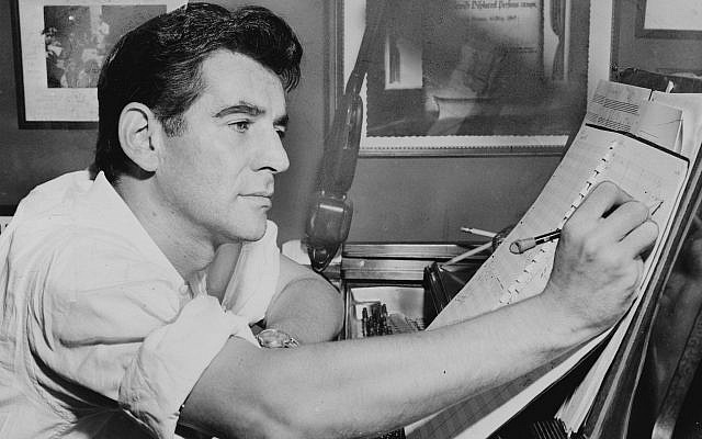 The citation presented to Leonard Bernstein by members of the orchestra in a Displaced Persons camp in Germany after he led them in a concert hangs on the wall in this iconic 1955 image of a young Leonard Bernstein, composing in his studio. (Al Ravenna/Library of Congress)