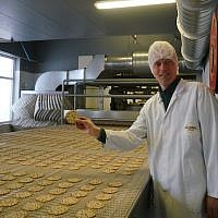 Pieter Heijs shows his product at his Hollandia Matzes factory in Enschede, the Netherlands, March 19, 2018. (Cnaan Liphshiz/JTA)