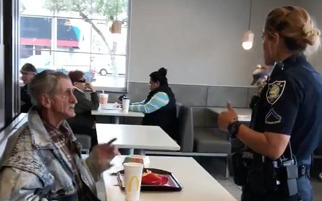 Video of a police officer telling a homeless man Yossi Galon bought food for that he must leave the McDonald's in Myrtle Beach, South Carolina. (Screen capture: Facebook)