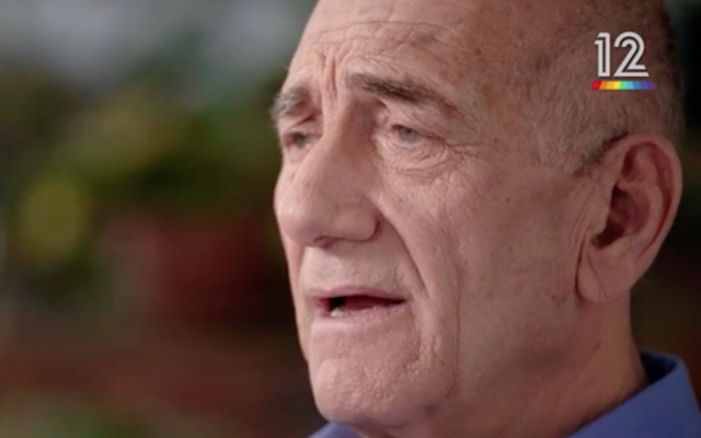 Former prime minister Ehud Olmert in a Keshet TV interview broadcast on March 17, 2018 (Keshet screenshot)