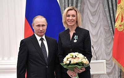 Russian President Vladimir Putin (l) and Russian foreign ministry spokeswoman Maria Zakharova, on January 26, 2017. (CC BY Kremlin.ru, Wikimedia Commons)