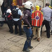 Medics tend to an Israeli victim of a stabbing attack in the Old City of Jerusalem on March 18, 2018. (Ir Amim)