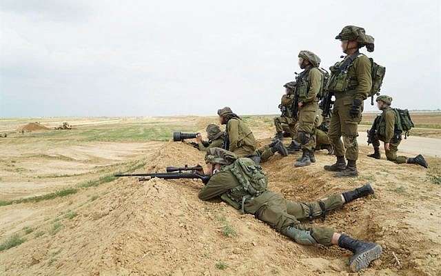 Israeli snipers prepare for massive protests by Palestinians in Gaza and the potential for demonstrators to try to breach the security fence on March 30, 2018. (Israel Defense Forces)