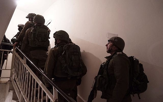 IDF troops prepare the home of Palestinian terrorist Abd al-Rahman Bani Fadel for demolition in the northern West Bank village of Aqraba on March 19, 2018. (Israel Defense Forces)