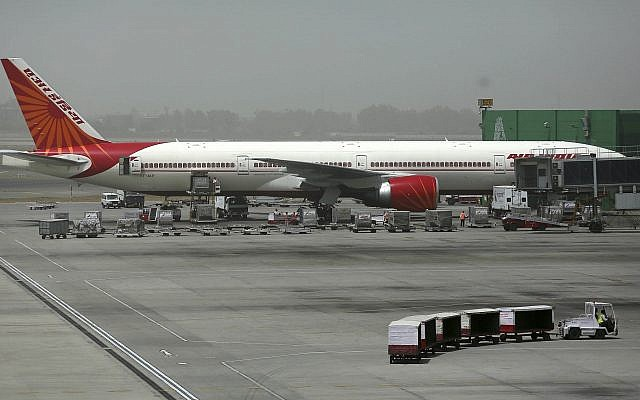 An Air India aircraft seen parked on the tarmac at Terminal 3 of Indira Gandhi International Airport in New Delhi, India,  May 18, 2012. (AP Photo/Kevin Frayer)