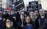 Members of the Jewish community hold a protest against Britain's opposition Labour Party leader Jeremy Corbyn and anti-Semitism in the  Labour party, outside the British Houses of Parliament in central London on March 26, 2018. (AFP/Tolga Akmen)