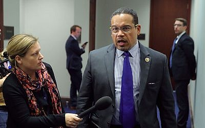 Keith Ellison (r), talking to reporters as he leaves a House Democratic caucus meeting at the US Capitol, February 8, 2018. (Chip Somodevilla/Getty Images via JTA)