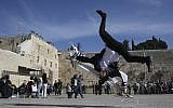 Ultra-Orthodox Hayat brothers practice Capoeira, a Brazilian martial art that combines elements of dance, acrobatics and music, in the Western Wall in Jerusalem's Old City. (Nati Shohat /FLASH90)