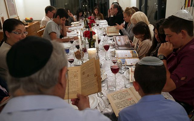 Illustrative: An Israeli family seen during the Passover Seder on April 3, 2015. (Nati Shohat/Flash90)