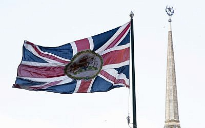British national flag flutters in front of the British Embassy with the Ukraine Hotel, right, in the background, in Moscow, Russia, Friday, March 16, 2018. (AP Photo/Pavel Golovkin)